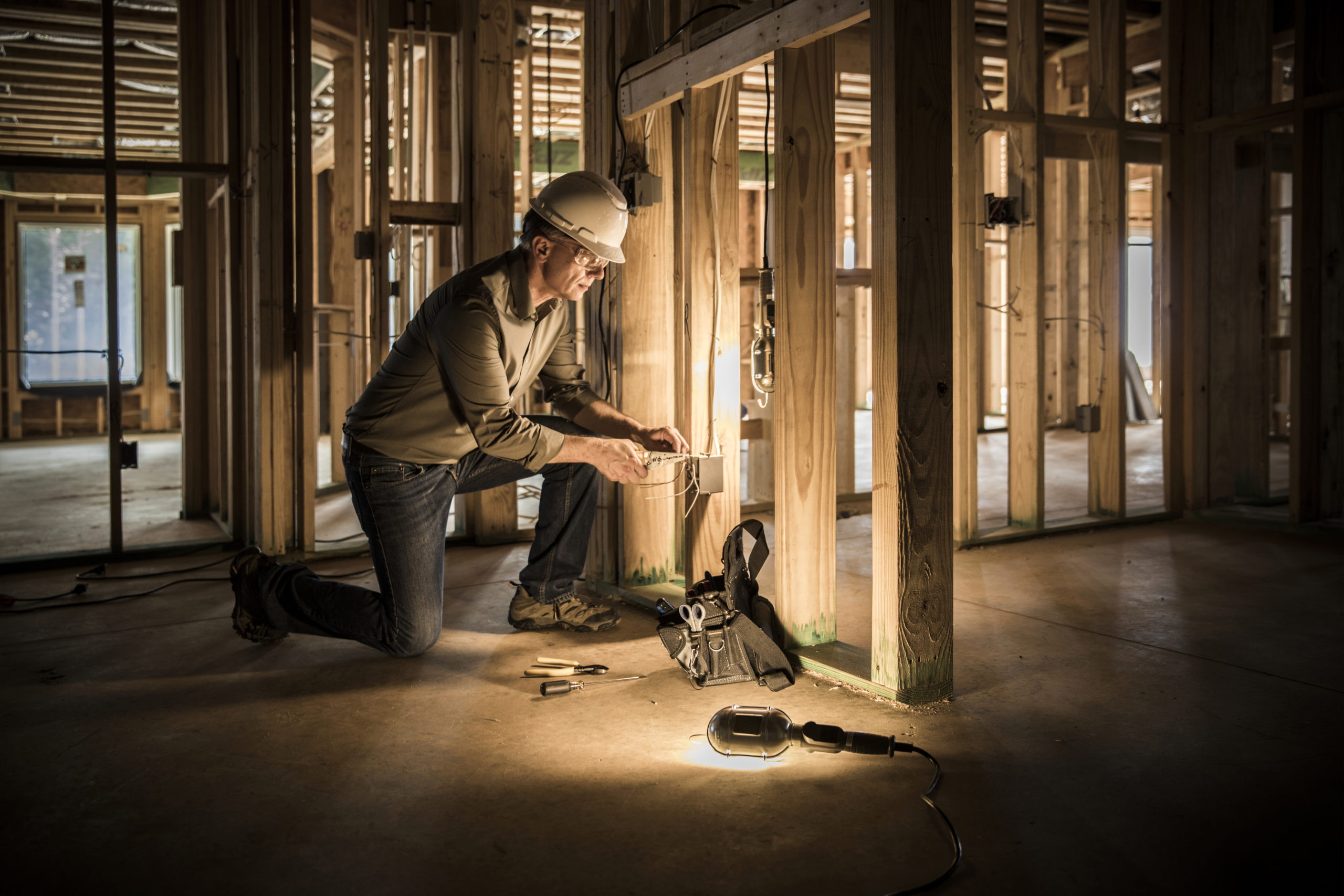 Electrician at home construction site.