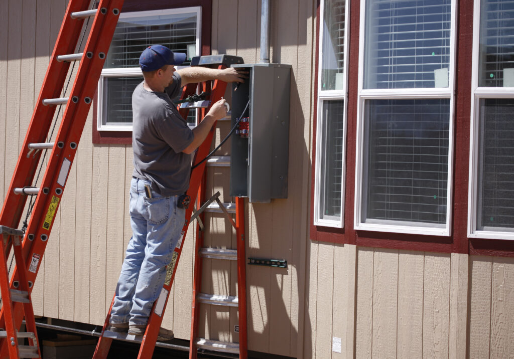 Electrician working on a new service for a manufactured home.